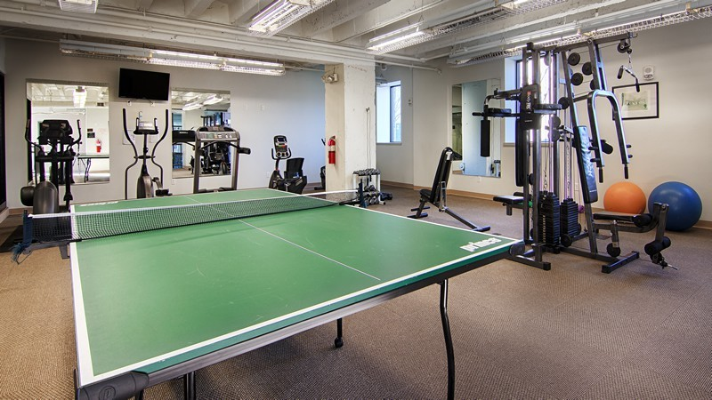 gym with ping pong table and exercise equipment