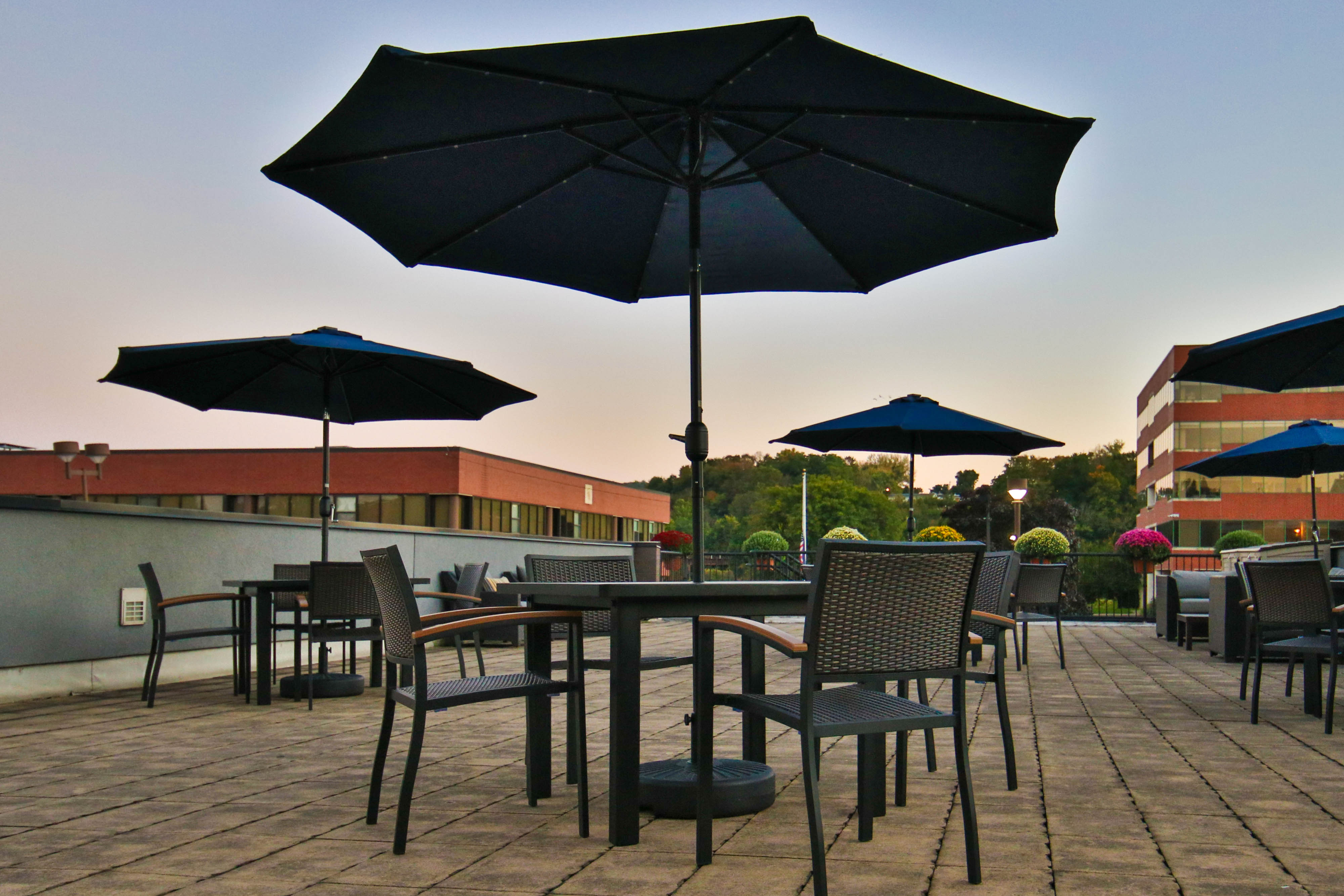 outdoor terrace with tables with umbrellas, and chairs